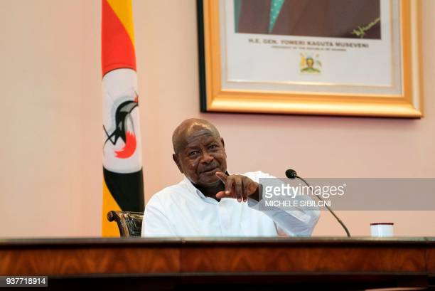 Ugandan President Yoweri Museveni reacts during a press conference with his Rwandan counterpart at the State House in Entebbbe Uganda on March 25...