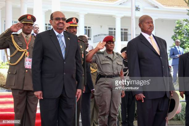 Ugandan President Yoweri Museveni stands next to Sudanese President Omar alBashir during a welcoming ceremony for Bashir's official visit at the...