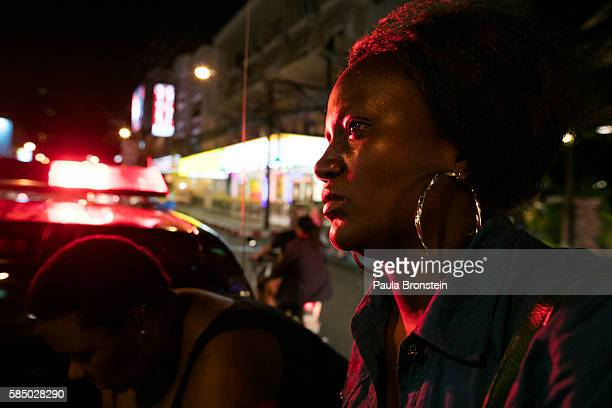 A Ugandan prostitute sits inside a police truck after being arrested July 30 2016 in Pattaya Thailand Thailand's first female minister of tourism...