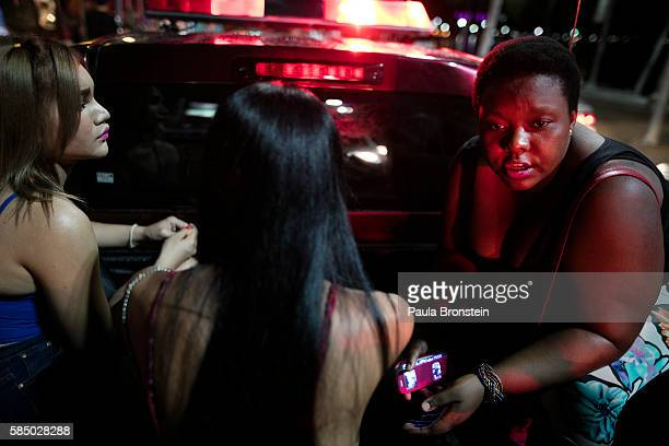 A Ugandan prostitute sits inside a police truck along side some local sex workers after being arrested July 30 2016 in Pattaya Thailand Thailand's...