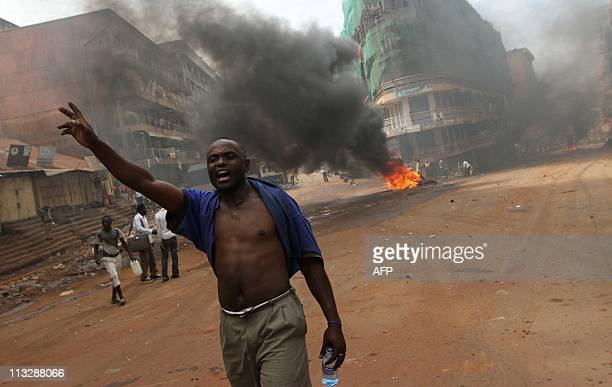 A Ugandan protestor shouts near a burning barricade in Kampala on April 29 2011 during disturbances a day after Uganda's opposition leader Kizze...