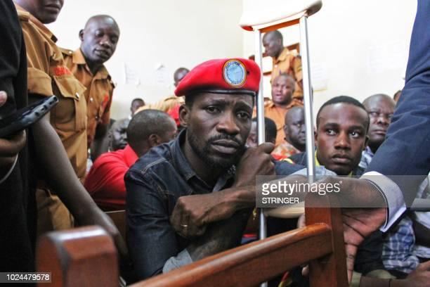 Ugandan singerturnedpolitician Robert Kyagulanyi better known as Bobi Wine appears at the High Court in Gulu northern Uganda on August 27 2018...