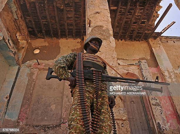A Ugandan soldier patrols a back street in the southern town of Merka 90kms north of Somalia's capital Mogadishu on July 17 as part of the African...