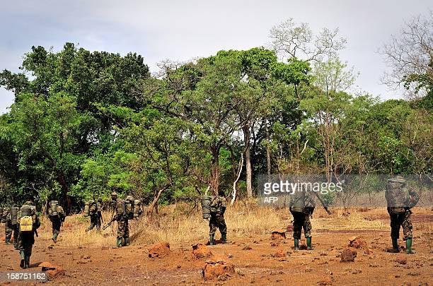 Ugandan soldiers patrol on April 18, 2012 through the central African jungle during an operation to fish out notorious Lord's Resistance Army leader...