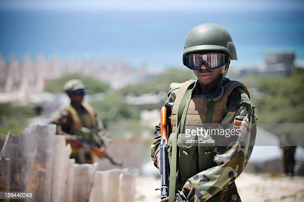 Ugandan soldiers watch Al Shabaab positions on the frontline in Karaan district on February 20, 2012 in Mogadishu, Somalia. As operations against Al...