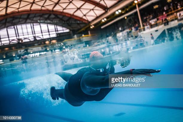 Ugandan swimmer Clare Byarugaba competes during the swimming competition at the 2018 Gay Games edition at The GeorgesVallerey swimming pool in Paris...