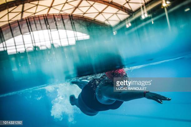 TOPSHOT Ugandan swimmer Clare Byarugaba competes during the swimming competition at the 2018 Gay Games edition at The GeorgesVallerey swimming pool...