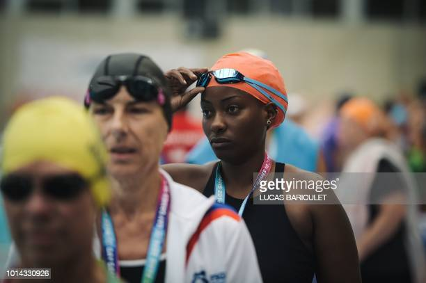 Ugandan swimmer Clare Byarugaba prepares to compete in a race during the swimming competition at the 2018 Gay Games edition at The GeorgesVallerey...