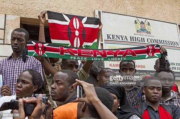 Ugandan University students hold Kenya's national flag and a scarf bearing Kenya's colors gather outside the Kenyan High Commission for an emotional...