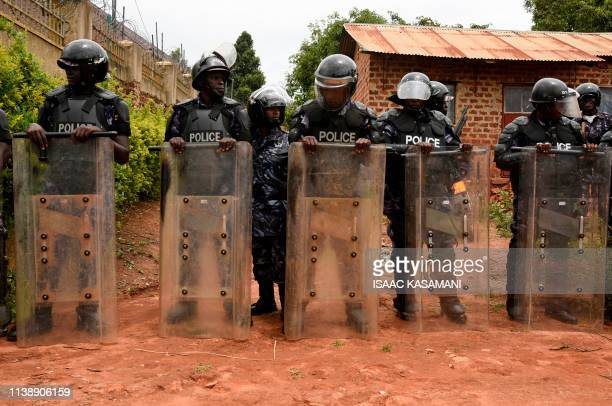 TOPSHOT Uganda's antiriot policemen stand guard in front of the house of Ugandan musician turned politician Robert Kyagulanyi commonly known by his...