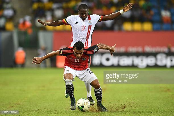TOPSHOT Uganda's forward Farouk Miya challenges Egypt's defender Mohamed AbdelShafy during the 2017 Africa Cup of Nations group D football match...