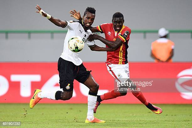 TOPSHOT Uganda's forward Muhammad Shaban challenges Ghana's defender John Boye during the 2017 Africa Cup of Nations group D football match between...