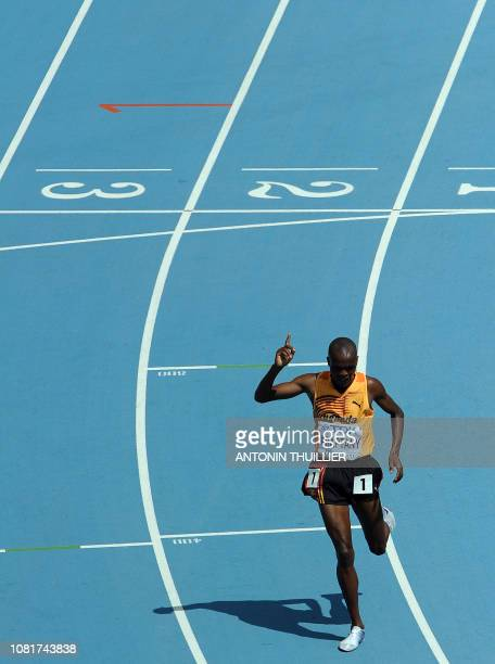 Uganda's Jacob Araptany gestures after competing in the men's 3000 metres steeplechase heats at the International Association of Athletics...