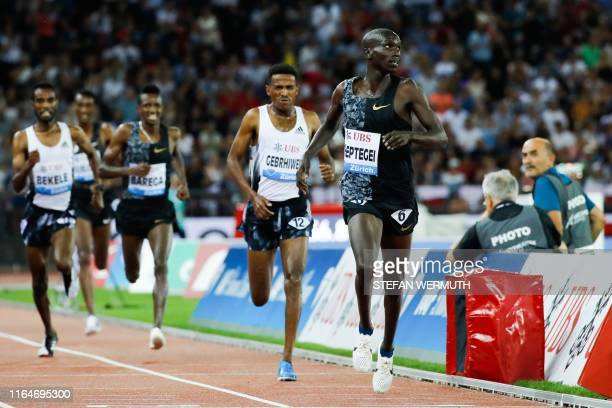 Uganda's Joshua Cheptegei cross the finsh line and wins the Men 5000m during the IAAF Diamond League competition on August 29 in Zurich.