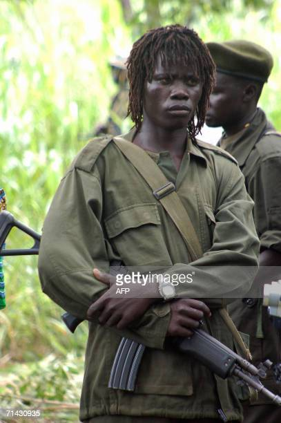 Uganda's Lord's Resistance Army fighter stands guard in the jungle along the 13 July 2006 Sudan-Democratic Republic of Congo border where south...