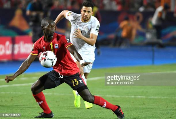 Uganda's midfielder Michael Azira chests the ball down during the 2019 Africa Cup of Nations Group A football match between Uganda and Egypt at the...