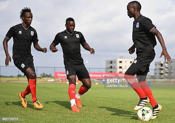 Uganda's midfielder Shafiq Batambuze Uganda's midfielder Khalid Aucho Uganda's defender Godfrey Walusimbi take part in a training session in...