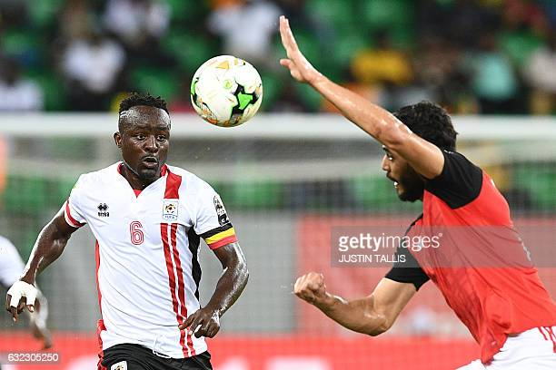 Uganda's midfielder Tony Mawejje challenges Egypt's defender Ali Gabr during the 2017 Africa Cup of Nations group D football match between Egypt and...