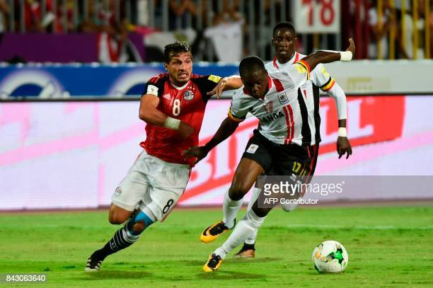 Ugandas player Farouk Miya and Egypts Tarek Hamed chase the ball during the FIFA World Cup 2018 qualification football match between Egypt and Uganda...