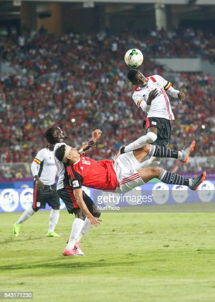 Uganda's player header the ball before Egyptian player Amr Gamal shot it During the 2018 World Cup group E qualifying soccer match between Egypt and...