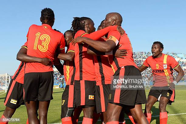 Uganda's players celebrate after midfielder Luwagga Kizito scored a goal during the AFCON 2017 qualifying match Botswana vs Uganda at the Francistown...
