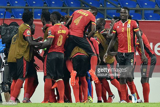 Uganda's players celebrate after scoring a goal during the 2017 Africa Cup of Nations group D football match between Uganda and Mali in Oyem on...