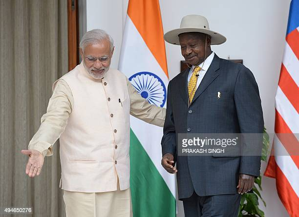 Uganda's President Yoweri Kaguta Museveni is welcomed by India's Prime Minister Narendra Modi during their meeting at the IndiaAfrica Forum Summit in...