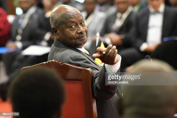 Uganda's President Yoweri Museveni gestures towards an aide during the 14th Summit of the Northern Corridor Integration Projects in Nairobi on June...
