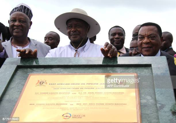 Uganda's President Yoweri Museveni poses with King of Bunyoro, Solomon Iguru the first and Minister of foreign Affairs of Tanzania Dr. Augustine...