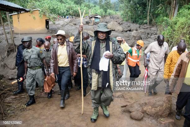 TOPSHOT Ugandas President Yoweri Museveni visits to the floodravaged village of Wanjenwa eastern Uganda on October 14 2018 At least 43 people were...
