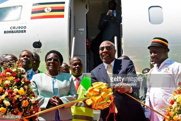 Ugandas Prime Minister Ruhakana Rugunda flanked by Minister of World and Transprt Eng Monica Azuba Ntege and the State Minister for Tourism Godfrey...