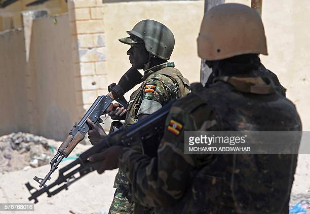 Uganda's soldiers patrol a back street in the southern town of Merka 90kms north of Somalia's capital Mogadishu on July 17 as part of the African...