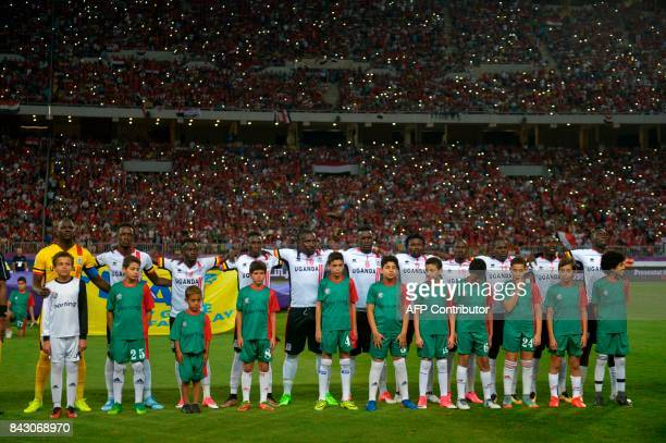 Ugandas team stand in line before the FIFA World Cup 2018 qualification football match between Egypt and Uganda at the Borg alArab Stadium near...