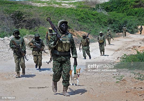 Uganda's troops part of the African Union Mission in Somalia patrol at southern town of Merka 90kms north of Somalia's capital Mogadishu on July 17...