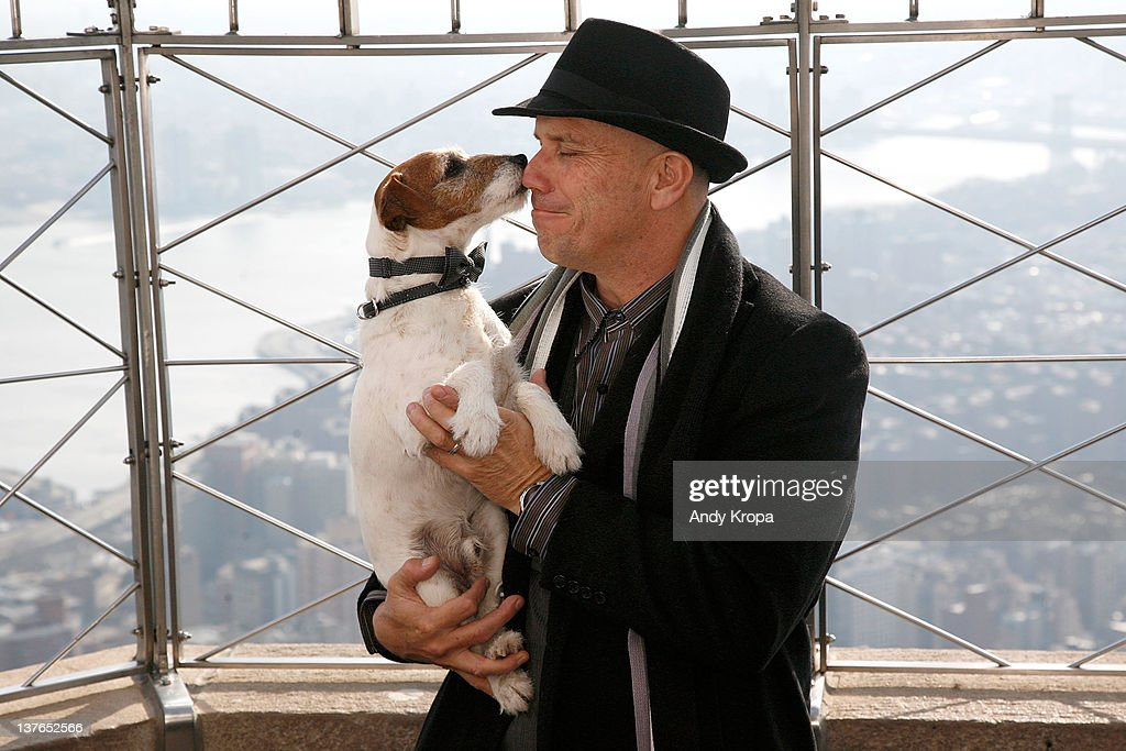 Uggie, a Jack Russell Terrier, visits The Empire State Building with his trainer Omar von Muller on January 24, 2012 in New York City.