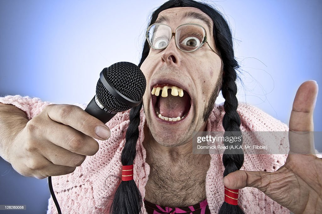Ugly Lady Singing Into Microphone High-Res Stock Photo - Getty Images