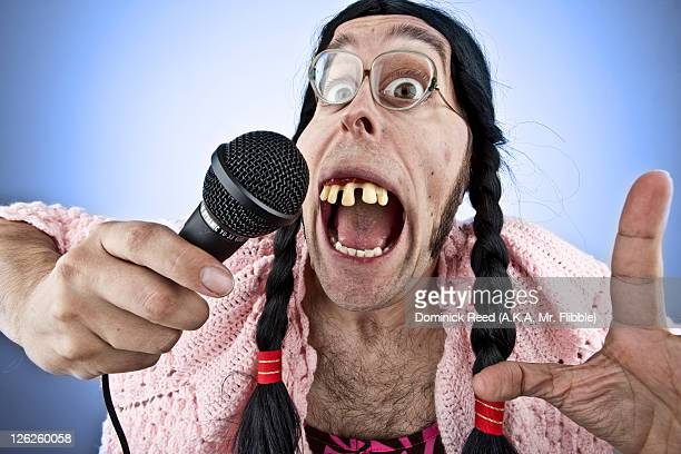 ugly lady singing into microphone - ugly people stock-fotos und bilder