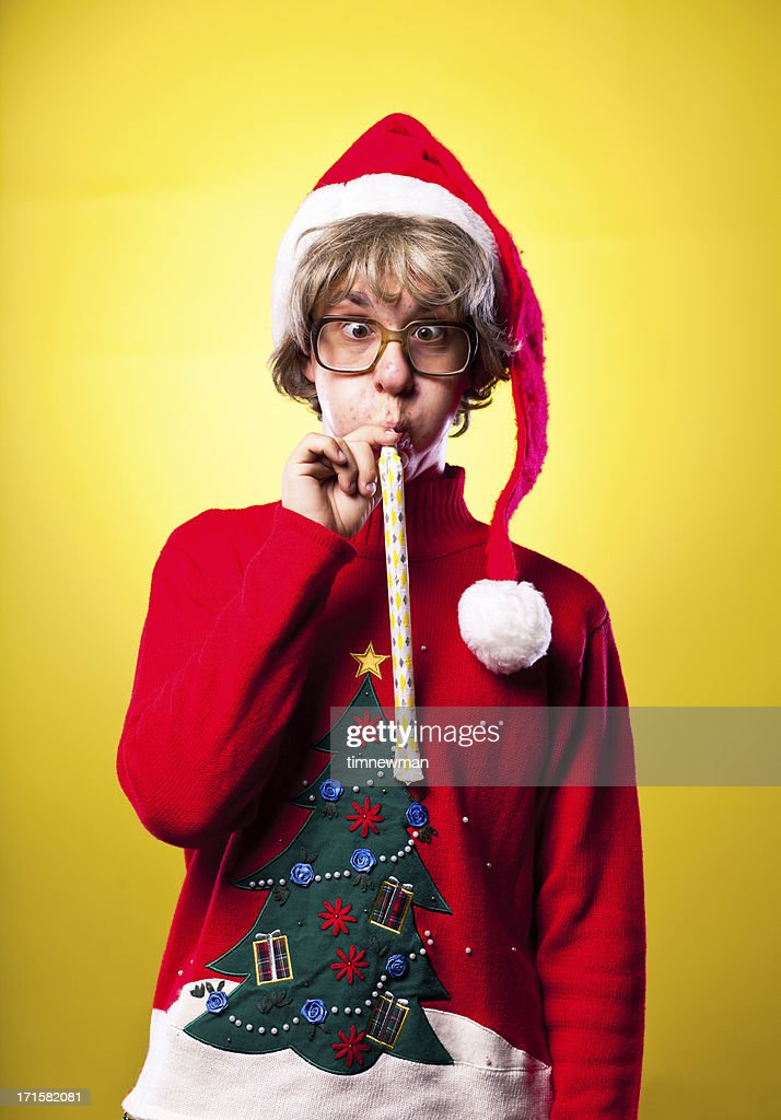 Ugly Sweater Christmas Nerd Boy Portrait Blowing Party Whistle : Stock Photo