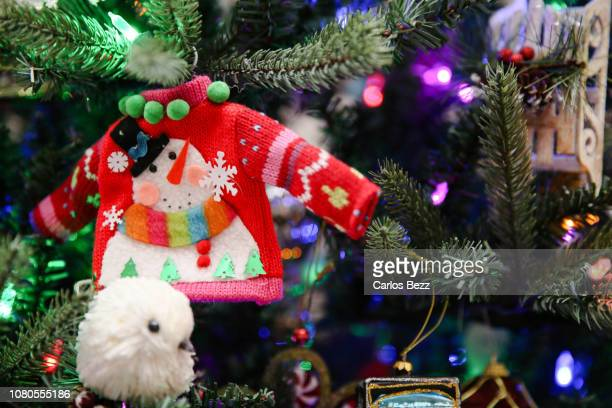 ugly sweater ornament on christmas tree - ugly wallpaper stock photos and pictures