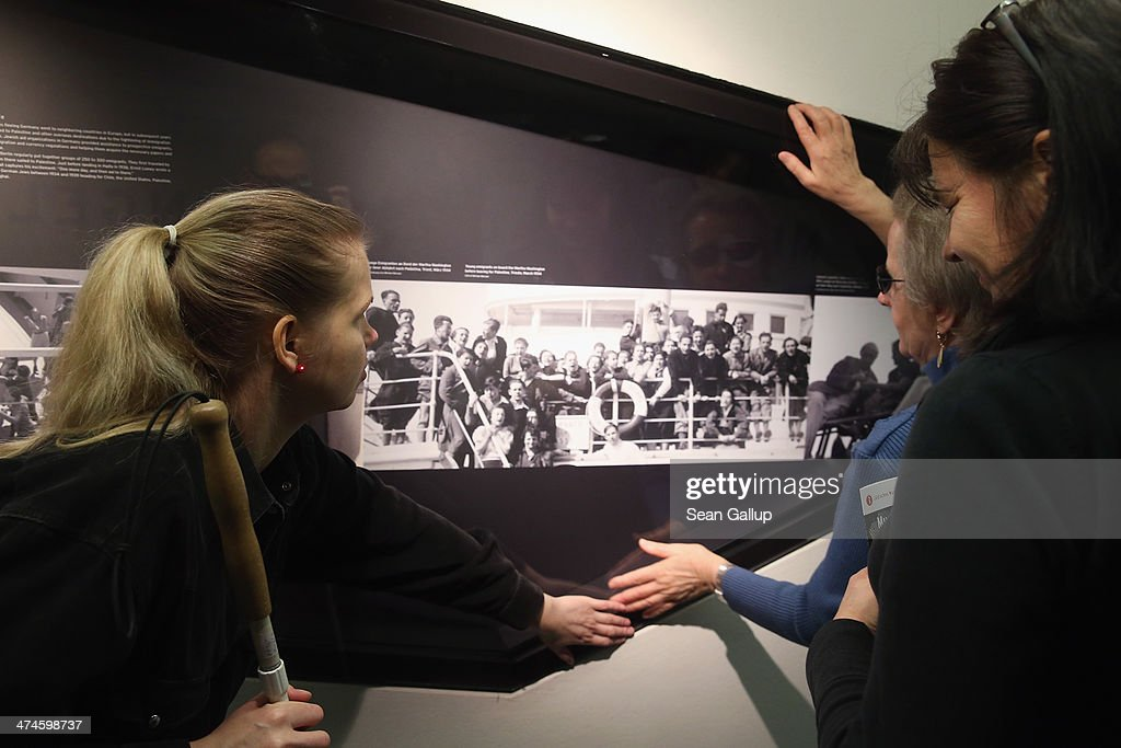 Ugne Metzner (L), who has been blind due to an illness since she was 21, and Roswitha Roeding (in blue), use their hands to explore a display on the first organized architectural tour of the museum for blind people at the Jewish Museum Berlin on February 21, 2014 in Berlin, Germany. The tours, which will be offered four times a year but can also be booked on other occasions, are geared specifically to what a blind person would be most able to appreciate in the building known for its tilted planes and narrowing spaces and designed by American architect Daniel Libeskind.