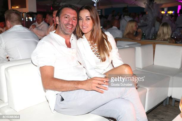 Ugo Crocamo and his girlfriend Melanie Fischer during the H'ugo's white night party at H'ugo's Undosa Beach Club on July 29 2017 in Starnberg near...