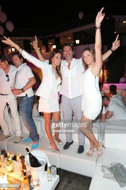 Ugo Crocamo his girlfriend Melanie Fischer and Simone Ballack during the H'ugo's white night party at H'ugo's Undosa Beach Club on July 29 2017 in...