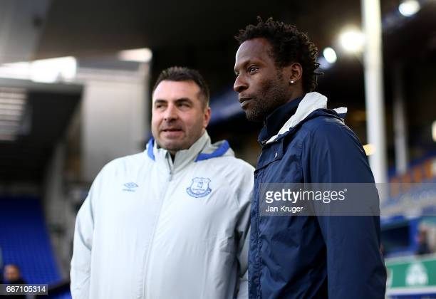 Ugo Ehiogu coach of Tottenham Hotspur chats with Manager of Everton David Unsworth ahead of kick off during the Premier League 2 match between...
