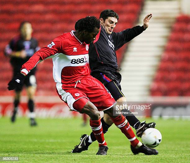 Ugo Ehiogu of Middlesbrough and Jonathan Macken challenge for the ball during the Carling Cup Fourth Round match between Middlesbrough and Crystal...