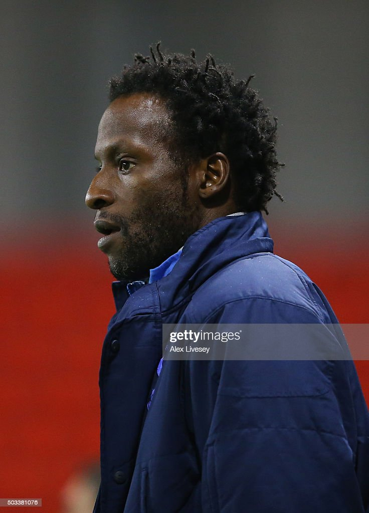 Ugo Ehiogu the manager of Tottenham Hotspur U21 looks on during the Barclays U21 Premier League match between Manchester United U21 and Tottenham Hotspur U21 at Leigh Sports Village on January 4, 2016 in Leigh, Greater Manchester.