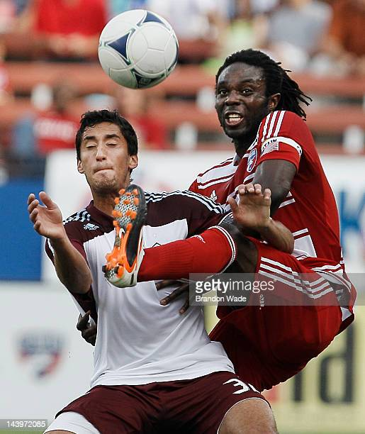Ugo Ihemelu of the FC Dallas and Tony Cascio of the Colorado Rapids battle for control of the ball during the first half of a soccer game at FC...