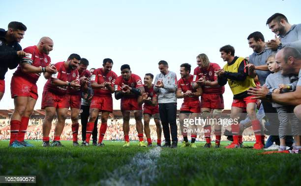 Ugo Mola Head Coach of Toulouse celebrates with his players following their victory during the Champions Cup match between Toulouse and Leinster...