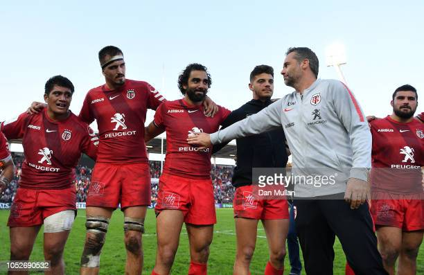 Ugo Mola Head Coach of Toulouse congratulates Yoann Huget of Toulouse following victory during the Champions Cup match between Toulouse and Leinster...