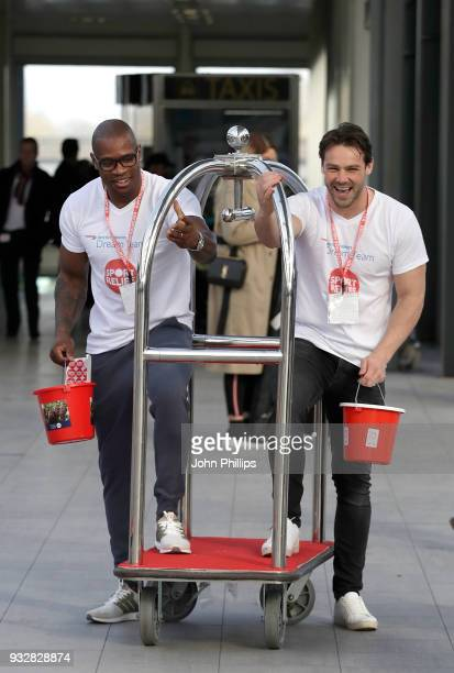 Ugo Monye and Ben Foden help British Airways customers with baggage at Gatwick Airport to raise money for Sport Relief on March 16, 2018 in London,...
