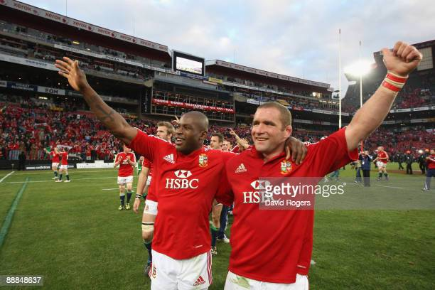 Ugo Monye celebrates with Lions team mate Phil Vickery after their victory in the Third Test match between South African and the British and Irish...